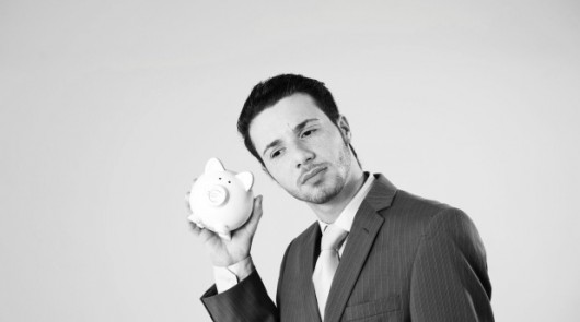 Young man with piggy bank